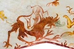 恶魔作为幻想动物,一幅哥特式壁画 库存照片