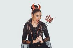 恶魔狂欢节服装的妇女 免版税图库摄影