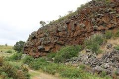 恶魔的厨房,在Creswick附近,是玄武岩峭壁一道陡峭支持的峡谷侧Woady Yaloak河的 免版税图库摄影