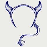 恶魔的垫铁和尾巴 免版税库存照片
