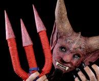 恶魔的面具有三叉戟的 库存图片