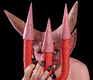 恶魔看从三叉戟的后面 免版税图库摄影