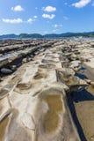 恶魔` s洗衣板海岸线和海滩在Aoshima海岛, Miyazak 库存图片