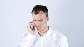 恼怒人电话联系 免版税图库摄影