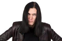 恼怒的不拘形式的人画象有长的头发的 免版税库存照片