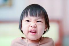 恼怒的亚裔女孩 库存照片