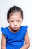 恼怒的亚洲女孩特写在白色背景中 免版税图库摄影