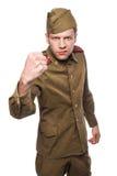 恼怒的俄国战士威胁与拳头 免版税库存照片