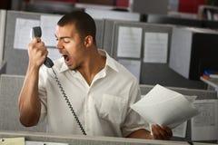 恼怒的办公室工作者 免版税库存照片