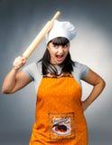恼怒的厨师妇女 库存图片