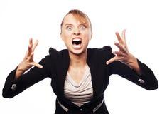 恼怒的叫喊的女实业家 库存照片