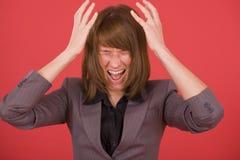 恼怒的叫喊的妇女 免版税库存照片