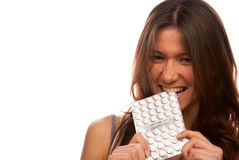 恼怒的叮咬包装药片俏丽的片剂妇女 图库摄影