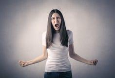 恼怒的呼喊的妇女 免版税库存图片