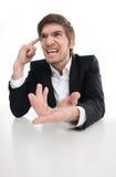 恼怒的商人。A 免版税库存图片