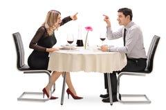 恼怒的夫妇争论互相 图库摄影