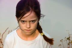 恼怒的女孩少年 图库摄影