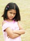 恼怒的女孩翻倒 免版税库存照片