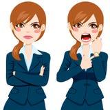 恼怒的女实业家晚概念 免版税库存图片