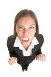 恼怒的女实业家查出 免版税库存图片