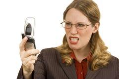 恼怒的女实业家 库存图片