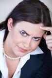 恼怒的女实业家 免版税图库摄影