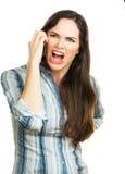 恼怒的妇女尖叫在电话 免版税库存照片