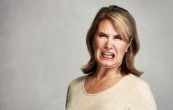 恼怒的妇女 库存照片