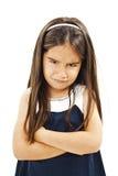 恼怒的小女孩丝毫被折叠的手 库存照片