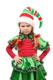 恼怒的小女孩-圣诞老人的矮子。 库存图片