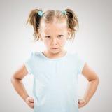 恼怒的小女孩 库存照片