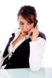恼怒的总公司女性电话联系的妇女 免版税图库摄影