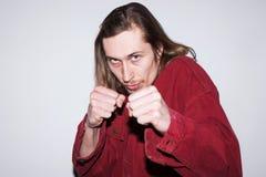 恼怒的战斗人 整理关系 免版税库存照片