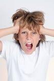 恼怒的沮丧的青少年的男孩 免版税库存照片