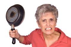 恼怒的油煎的母亲平底锅 库存图片