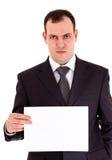 恼怒的生意人纸张显示 库存照片