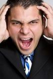 恼怒的生意人讲西班牙语的美国人 免版税库存照片