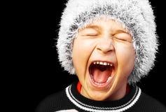 恼怒的男孩滑稽的尖叫 库存照片