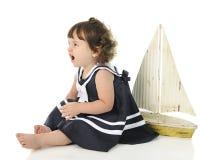 恼怒的矮小的水手女孩 库存照片