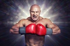 恼怒的秃头拳击手的综合图象有猛击的手套的 库存图片