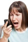 恼怒的移动电话联系的妇女 免版税图库摄影