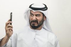 恼怒的阿拉伯商人,表示阿拉伯的商人愤怒 免版税库存照片