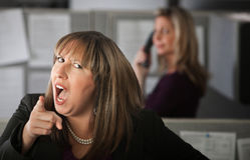 恼怒的雇员妇女 库存照片