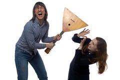 恼怒的年轻人和叫喊的妇女 图库摄影
