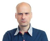 恼怒秃头的人表示- 免版税库存照片