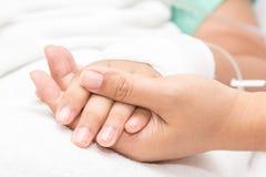 患者的手 免版税库存照片