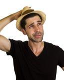 悦目年轻人戴帽子 免版税库存图片