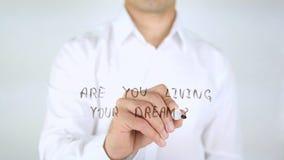 您居住您的梦想?在玻璃的人文字,手写 图库摄影