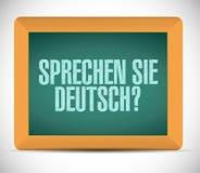 您讲德语 在委员会的标志消息 免版税库存照片