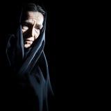 悲伤的压抑资深妇女 免版税库存照片